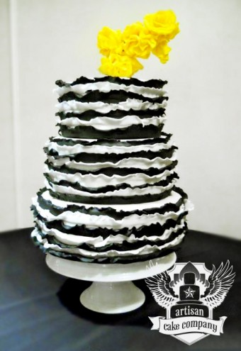 black and white ruffle cake with yellow roses