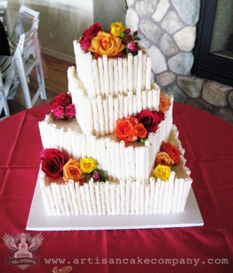 Four Tier Square Wedding Cake with Chocolate Cigars and Fresh Roses