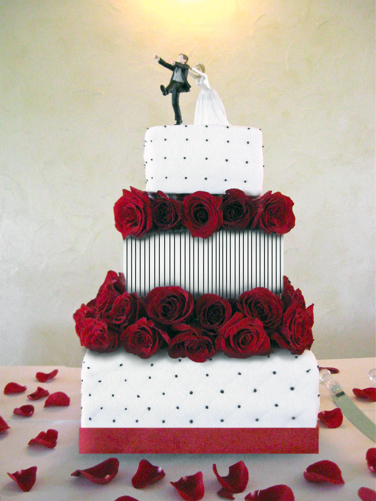Three tier wedding cake with fresh red roses to match a poker themed ...