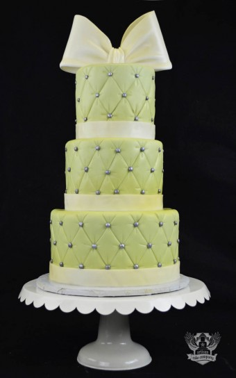 quilted green and yellow baby shower cake