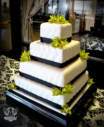 Square quilted wedding cake with green orchids