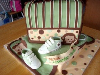 modern monkey themed baby shower cake for a boy