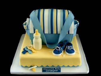 blue and yellow diaper bag cake for a boy