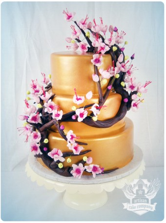 gold and cherry blossom baby shower cake